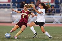 Penn's Maya Lacognato (12) and Brebeuf Jesuit's Natalie Kelley (8) play the ball during the IHSAA Class 2A Girls Soccer State Championship Game on Saturday, Oct. 29, 2016, at Carroll Stadium in Indianapolis. Special to the Tribune/JAMES BROSHER