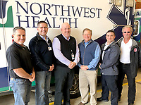 Photo submitted<br /> Gentry and Benton County officials joined with Northwest Health leaders to participate in a push-in ceremony at the Gentry Fire Department on Dec. 31. The ceremony marked the launch of EMS coverage in western Benton County, which began on Jan. 1.  Pictured, from left, are Kevin Johnston, Gentry Mayor; Charles Hall, Assistant CEO of Northwest Medical Center-Springdale; Robert McGowan, administrator of Benton County's Division of Public Safety; Barry Moehring, Benton County Jude; Mike Pittman, Director of EMS for Northwest Health; and Vester Cripps, Gentry Fire Chief.