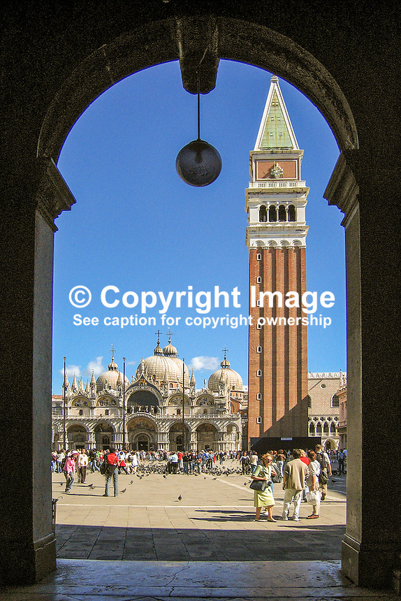 St Mark's Church and Campanile, St Mark's Square, Venice, Italy, framed by one of the cloisters which surround three side of the square. 200509300368...Copyright Image from Victor Patterson, 54 Dorchester Park, Belfast, UK, BT9 6RJ..Tel: +44 28 9066 1296.Mob: +44 7802 353836.Voicemail +44 20 8816 7153.Skype: victorpattersonbelfast.Email: victorpatterson@mac.com.Email: victorpatterson@ireland.com (back-up)..IMPORTANT: If you wish to use this image or any other of my images please go to www.victorpatterson.com and click on the Terms & Conditions. Then contact me by email or phone with the reference number(s) of the image(s) concerned.