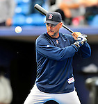 11 March 2010: Boston Red Sox Manager Terry Francona hits grounders to warm up his infielders prior to a Spring Training game against the New York Mets at Tradition Field in Port St. Lucie, Florida. The Red Sox defeated the Mets 8-2 in rain delayed Grapefruit League action. Mandatory Credit: Ed Wolfstein Photo