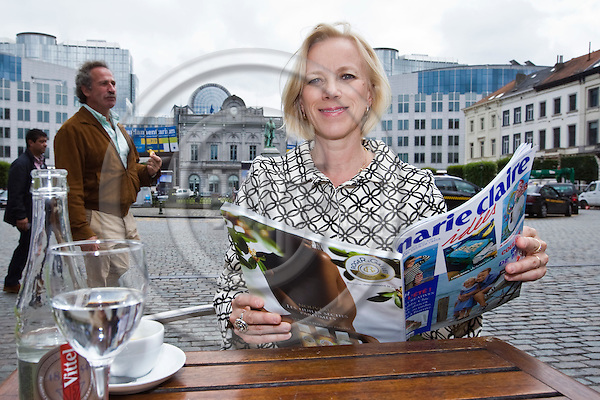BRUSSELS - BELGIUM - 27 JUNE 2012 -- Anu NISSINEN - CEO of Sanoma Media on Place Luxembourg havin a coffee on a terrace and reading the women's magazine Marie Claire. The Dutch Edition of the magazine is published by Sanoma Media. --  PHOTO: Juha ROININEN /  EUP-IMAGES