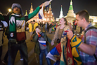 MOSCOW, RUSSIA - June 14, 2018: Mexico and Russia fans cheer at Manezhnaya Plaza just outside Red Square after the opening match of the 2018 FIFA World Cup between Russia and Saudi Arabia. Russia defeated Saudi Arabia 5-0.