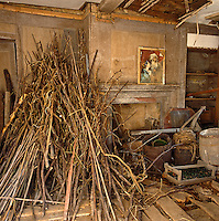 A former living room has been used as a barn, its ceiling and floor in a bad state of disrepair, National Trust for Jersey
