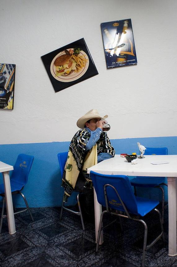 Portait of a man drinking beer. Night bike rides in Mexico City