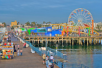 Pacific Park Pier Santa Monica CA pier near sunset,family amusement park large New Pacific Ferris wheel Roller Coaster moving over the ocean
