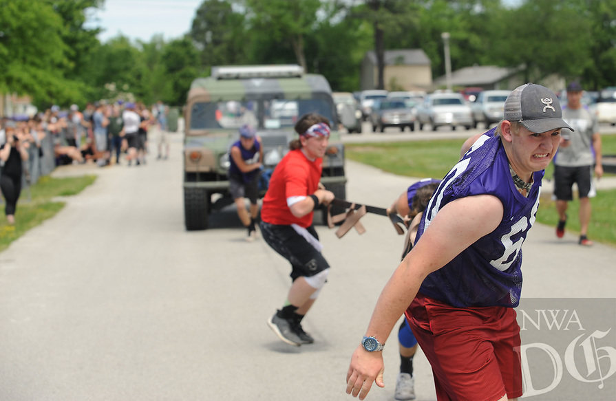 NWA Democrat-Gazette/ANDY SHUPE<br /> Logan Shoffitt, 16, a sophomore at Elkins High School, leads a team of fellow sophomore students Tuesday, May 2, 2017, to pull a Elkins Police HMMWV, a former military vehicle weighing nearly 6,000 pounds, in a competition between classes in the annual Herd Wars at the school. Students pay a dollar to attend the games, which include court games and obstacle courses, to fund a scholarship for an Elkins student.