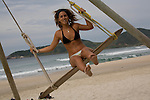 A young Argentinian woman tries out the surf swing on Praia do Rosa beach near Vida Sol e Mar Eco Resort, Santa Catarina, Brazil