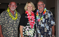 NWA Democrat-Gazette/CARIN SCHOPPMEYER Bill Bowen (from left), Jenna Johnstson and Pat Pickett, Elizabeth Richardson Center board members welcome guest to the Beach Bingo Bash.