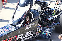 Apr 25, 2015; Baytown, TX, USA; A crew member in the car of NHRA top fuel driver Spencer Massey during qualifying for the Spring Nationals at Royal Purple Raceway. Mandatory Credit: Mark J. Rebilas-
