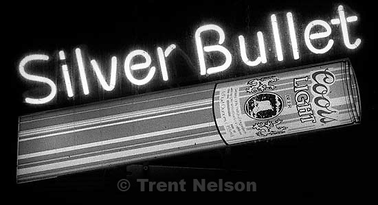 Coors Light Silver Bullet neon sign at LaMar's bar.<br />