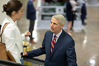United States Senator Rob Portman, Republican of Ohio talks with a staffer in the Senate Subway during a Senate vote on Capitol Hill in Washington, DC on July 7, 2018. <br /> CAP/MPI/RS<br /> &copy;RS/MPI/Capital Pictures