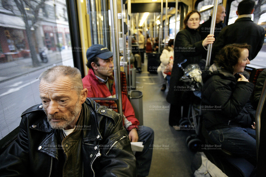 Switzerland. Geneva. Poverty in Geneva. Arnold Masy, 68 years old, from Belgium. Homeless. In order to avoid the cold weather, Arnold Masy rides the public bus through the town. Model Released. © 2005 Didier Ruef