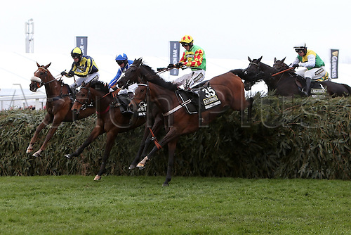 09.04.2016. Aintree, Liverpool, England. Crabbies Grand National Festival Day 3. Hadrians Approach, ridden by jockey Nico De Boinville leads the field over The Chair for the first time.