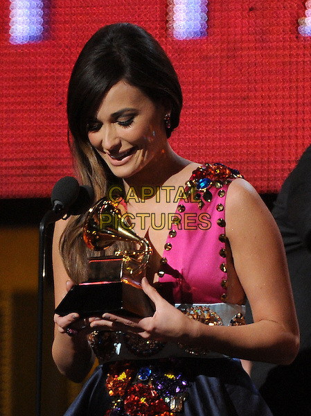 LOS ANGELES, CA - JANUARY 26 : Kacey Musgraves accepts the Best Country Album award onstage at The 56th Annual GRAMMY Awards at Staples Center on January 26, 2014 in Los Angeles, California.<br /> CAP/MPI/PG<br /> &copy;PGFMicelotta/MediaPunch/Capital Pictures