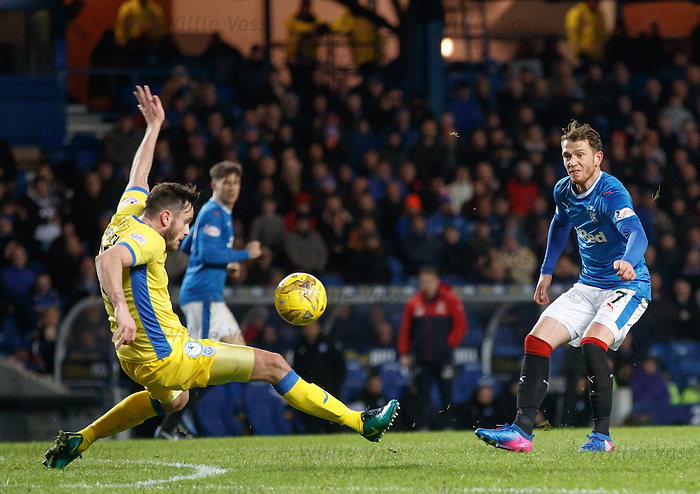 Joe Garner has a shot blocked