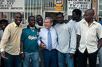 JOHANNESBURG, SOUTH AFRICA - APRIL 1: Sol Kerzner, the South African hotel magnate, talks to African immigrants while visiting his old neighborhood in Bez Valley on April 1, 2009 in Johannesburg, South Africa. Mr. Kerzner has finally returned to SA after spending many years overseas developing hotels. He opened a One&Only Hotel in Cape Town on April 3, 2009. (Photo by Per-Anders Pettersson)