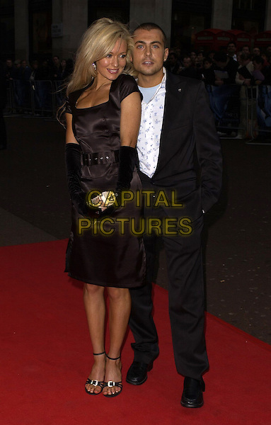"NICCI LEGG & PAUL DANAN.World Premiere of ""Three"" at the Odeon West End, Leicester Square, London, UK..May 2nd, 2006.Ref: CAN.full length black satin dress nikki nicki suit gloves.www.capitalpictures.com.sales@capitalpictures.com.©Capital Pictures"