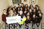 FLOOD RELIEF: Students of Gaelchola?iste Chiarrai in Tralee presenting the proceeds of their Christmas Carol Singing to the local branch of the Irish Red Cross with front l-r: Padraig O? Da?laigh (Principal), Norma Lee (Chairperson, Parents Council), Charlie Harnett (Area Director, Red Cross).