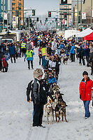 Ketil Reitan leads a procession of mushers as they walk their dogs down 4th avenue to the start line during the Ceremonial Start of the 2016 Iditarod in Anchorage, Alaska.  March 05, 2016