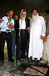 Jewish rabbi Menachem Froman leads a reconciliation visit of Jewish settlers to the West Bank village of Qusra, a day after the local mosque was vandalized, Tuesday, Sept. 6, 2011. The mosque was torched Monday after Israeli military demolished buildings in an authorized Jewish settlement outpost. The name of the outpost, Migron, was spray painted on the mosque, suggesting the act was settler retaliation for the demolitions. Photo by Wagdi Eshtayah