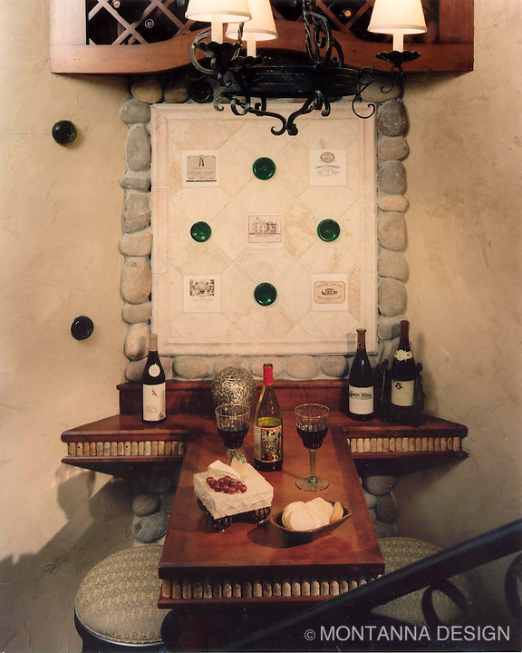 Wine bottle ends embedded in stone with wine label wall tiles and wine cork edge detail at the tasting table