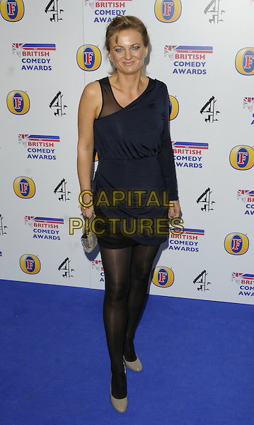 ALICE BEER .Attending the British Comedy Awards 2011 at Indigo, The O2 Arena, London.England, UK, January 22nd, 2011..arrivals full length blue topshop navy black one sleeve dress tights  mini clutch bag shoes beige grey gray .CAP/CAN.©Can Nguyen/Capital Pictures.