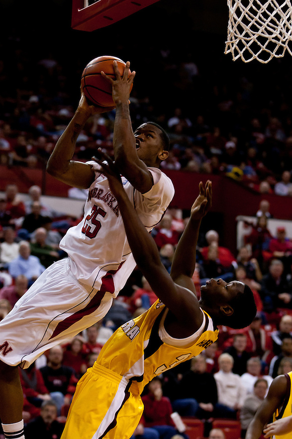 20 December 2011: Caleb Walker #25 of the Nebraska Cornhuskers goes for a lay up against Jevon Harden #35 of the Central Michigan Chippewas during the second half at the Devaney Sports Center in Lincoln, Nebraska. Nebraska defeated Central Michigan 72 to 69.