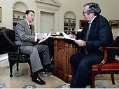 United States President Ronald Reagan meets with Howard Baker, Chief of Staff to the President in the Oval Office of the White House in Washington, D.C. on March 2, 1987.<br /> Mandatory Credit: Bill Fitz-Patrick - White House via CNP