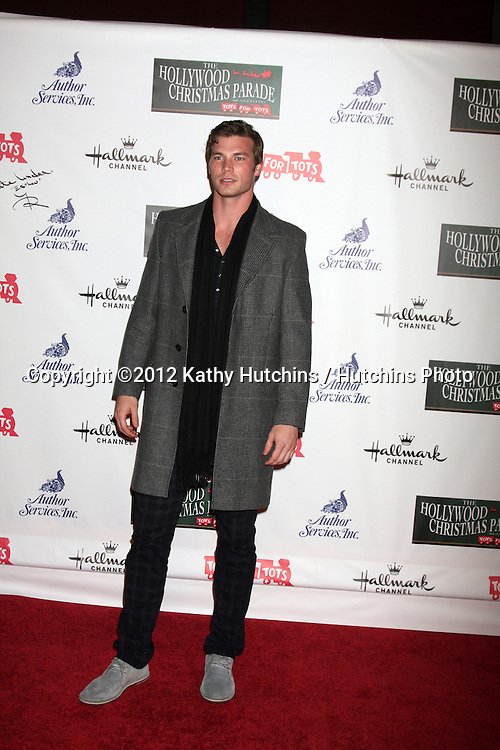LOS ANGELES - NOV 25:  Derek Theler arrives at the 2012 Hollywood Christmas Parade at Hollywood & Highland on November 25, 2012 in Los Angeles, CA