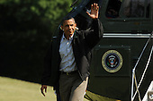 United States President Barack Obama waves while walking across the South Lawn of the White House after arriving by Marine One, in Washington DC, USA, Sunday, 10 July 2011..Credit: Michael Reynolds / Pool via CNP