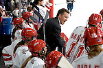 MADISON, WI - SEPTEMBER 29: Head coach Mark Johnson of the Wisconsin Badgers women's hockey team communicates with his players against the Quinnipiac Bobcats at the Kohl Center on September 29, 2006 in Madison, Wisconsin. The Badgers beat the Bobcats 3-0. (Photo by David Stluka)