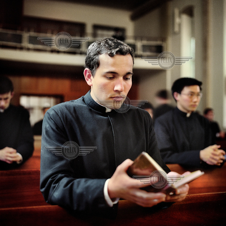 Juan Pablo Gallegos prays in the chapel at the Legionaries of Christ seminary in Salamanca. Juan was born in Mexico. The Legion of Christ is a conservative Roman Catholic congregation whose members take vows of chastity, obedience and poverty. They pray four times everyday.