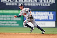 Second baseman Trevor Sprowl (9) of the Rome Braves tracks a ground ball in a game against the Greenville Drive on Sunday, August 3, 2014, at Fluor Field at the West End in Greenville, South Carolina. Sprowl is a pick of the Atlanta Braves in the 2014 First-Year Player Draft. Rome won, 4-2. (Tom Priddy/Four Seam Images)