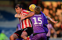 Lincoln City's Matt Rhead vies for possession with Port Vale's Nathan Smith, centre, and Port Vale's Antony Kay<br /> <br /> Photographer Chris Vaughan/CameraSport<br /> <br /> The EFL Sky Bet League Two - Lincoln City v Port Vale - Tuesday 1st January 2019 - Sincil Bank - Lincoln<br /> <br /> World Copyright © 2019 CameraSport. All rights reserved. 43 Linden Ave. Countesthorpe. Leicester. England. LE8 5PG - Tel: +44 (0) 116 277 4147 - admin@camerasport.com - www.camerasport.com