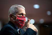 Anthony Fauci, director of the National Institute of Allergy and Infectious Diseases, gives a thumbs up during a Senate Health, Education, Labor and Pensions Committee hearing in Washington, D.C., U.S., on Tuesday, June 30, 2020. Top federal health officials are expected to discuss efforts to get back to work and school during the coronavirus pandemic.<br /> Credit: Al Drago / Pool via CNP /MediaPunch