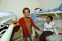 giovani somale nel centro per asilanti, richiedenti asilo politico,in un ex bunker a Biasca, Canton Ticino, Svizzera.
