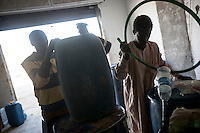 November 22, 2014 - Murzuq City, Libya: Sub-Sahara immigrants sell fuel in a black market shop in Murzuq City. Libya's borders remain largely ungoverned, and securing the periphery is among the country's greatest challenges. Weak border control allows markets in arms, people, and narcotics to thrive alongside everyday trafficking in fuel and goods, with profound consequences for the region as a whole. (Photo/Narciso Contreras)