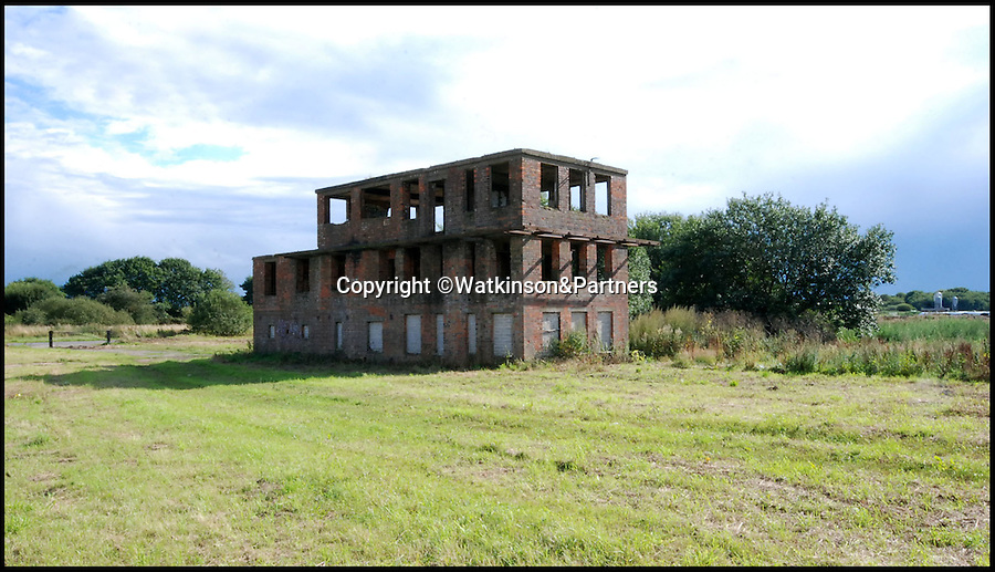 BNPS.co.uk (01202 558833)<br /> Pic: Watkinson&Partners/BNPS<br /> <br /> Chocks away...WW2 control tower up for sale.<br /> <br /> House hunters wanting to reach for the skies have a rare opportunity to buy a former WW2 control tower in the wide open spaces of Wigsley near Lincoln.<br /> <br /> Potential punters are scrambling to buy the historic bomber command site that is availble for a knock down price of £150,000.<br /> <br /> Despite its rather derelict state, planning permission exists to convert the former RAF base into a luxury three storey residential home with far reaching views over the surrounding countryside.