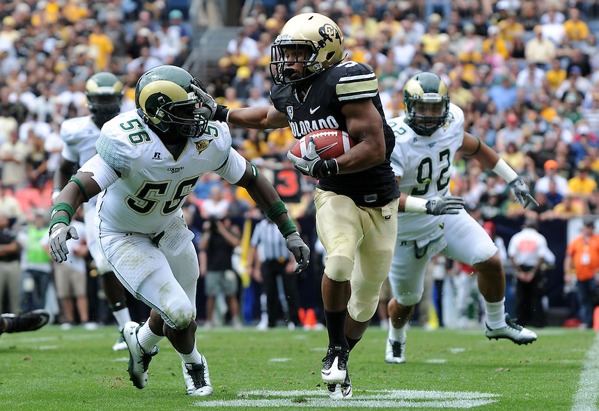 SEPTEMBER 17, 2011:   Colorado Buffaloes running back Rodney Stewart (5) stiff arms Colorado State Rams linebacker Shaquil Barrett (56)  during an inter-conference game between the Colorado State Rams and the University of Colorado Buffaloes at Sports Authority Field at Mile High Field in Denver, Colorado. The Buffaloes led 14-7 at halftime*****For editorial use only*****
