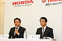 Honda Motor Operating Officer and Director Shinji Aoyama, left, and Yamaha Motor Managing Executive Officer and Director Katsuaki Watanabe attends a joint press conference in Tokyo, Japan on October 5, 2016. Japanese auto majors Honda and Yamaha announced they have started talks toward a business tie-up in the development and production of small scooters. (Photo by Yosuke Tanaka/AFLO)