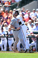 Detroit Tigers infielder Aaron Westlake (80) runs into Adam Jones (10) while making a play during a Spring Training game against the Baltimore Orioles on March 4, 2015 at Ed Smith Stadium in Sarasota, Florida.  Detroit defeated Baltimore 5-4.  (Mike Janes/Four Seam Images)