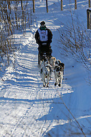 Saturday, February 24th, Knik, Alaska.  Jr. Iditarod musher Garry McKeller on the trail shortly after leaving the Knik start