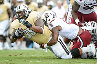 September 28, 2013 - Orlando, FL, U.S: UCF Knights defensive lineman E.J. Dunston (95) is tackled after returning the ball after a partially blocked punt during 1st half NCAA football game action between the South Carolina Gamecocks and the UCF Knights at Bright House Networks Stadium in Orlando, Fl