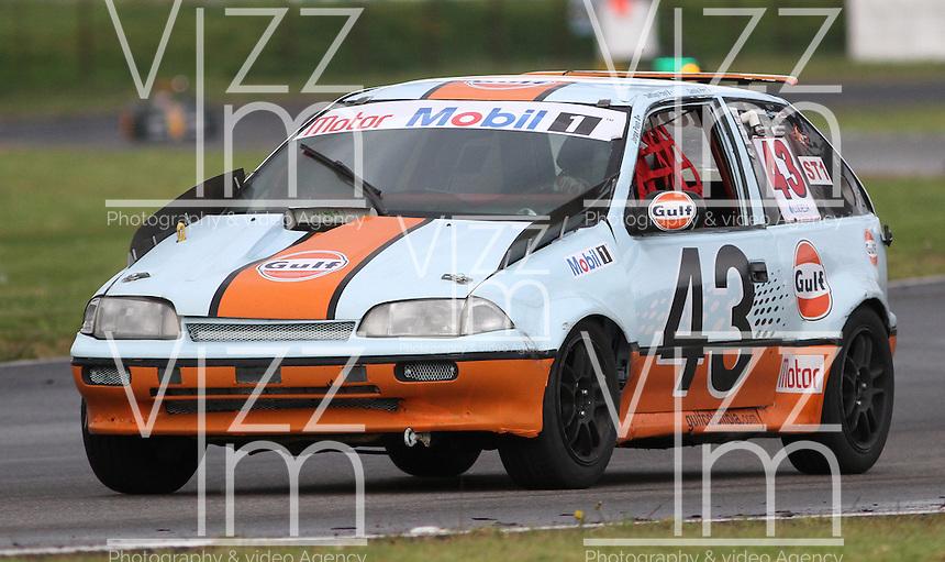 TOCANCIPA-COLOMBIA, 6-DICiEMBRE-2014. Camilo Puyo y Jorge Puyo    , Class  ST 1 Superturismos  0 a 1.600 cc,  Auto swift  GTI , Patrocinadores Pulsar - Gulf  durante  las Seis Horas Motor-Mobil 1 que se disputo en el Autodromo de Tocancipa con la participacion de mas de 50  pilotos . / Pilots Camilo Puyo y Jorge Puyo , Class  ST 1 Superturismos  0 to 1.600 cc , Auto swift  GTI , Sponsors  Pulsar - Gulf Las Seis  Horas Motor-Mobil 1 that disputed in the  Tocancipa autodromo with the participation of over 50 pilots.Photo / VizzorImage / Felipe Caicedo  / Staff