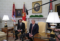 U.S. President Donald Trump meets with the Emir of Qatar Sheikh Tamim bin Hamad Al Thani, in the Oval Office at the White House, on April 10, 2018 in Washington, DC. President Trump has announced that he canceled his upcoming trip to the 8th annual Summit of the Americas in Lima, Peru.  <br /> <br /> CAP/MPI/RS<br /> &copy;RS/MPI/Capital Pictures