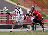 Chris Bocklet (10) of Virginia tries to curl around Drew Snider (32) of Maryland during the ACC men's lacrosse tournament finals in College Park, MD.  Virginia defeated Maryland, 10-6.