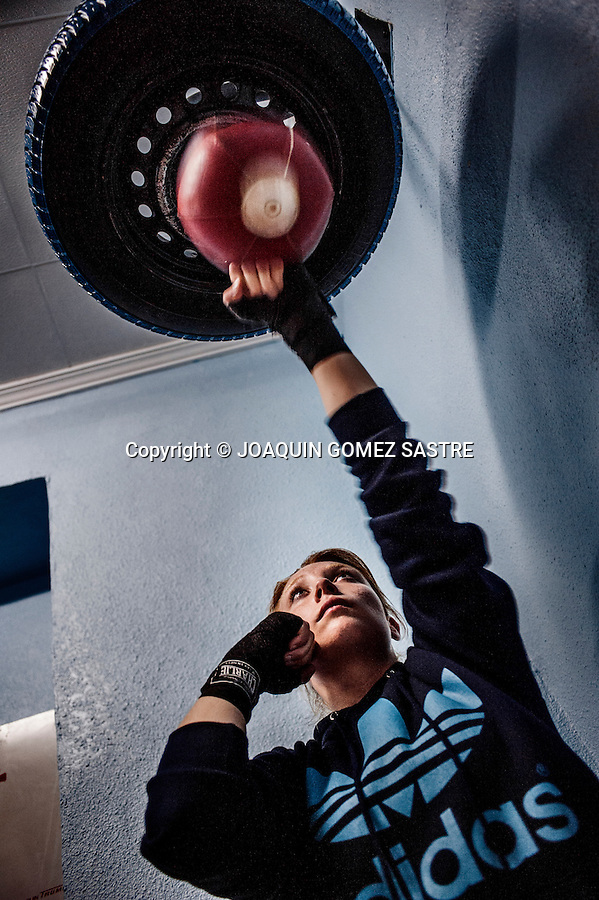 Maria Alicante a female boxer during boxing training boxing club in Martinez, hitting one of the devices