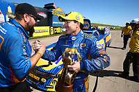 May 21, 2017; Topeka, KS, USA; NHRA funny car driver Ron Capps celebrates with crew members after winning his fourth straight victory following the Heartland Nationals at Heartland Park Topeka. Mandatory Credit: Mark J. Rebilas-USA TODAY Sports