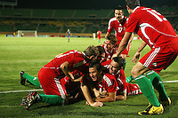 Hungary's Krisztian Nemeth (9) is piled on top of in celebration after his goal against Italy during the FIFA Under 20 World Cup Quarter-final match at the Mubarak Stadium  in Suez, Egypt, on October 09, 2009. Hungary won 2-3 in overtime.