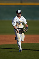 Wingate Bulldogs second baseman McCann Mellett (9) reacts after having picked a runner off of second base against the Concord Mountain Lions at Ron Christopher Stadium on February 2, 2020 in Wingate, North Carolina. The Mountain Lions defeated the Bulldogs 12-11. (Brian Westerholt/Four Seam Images)
